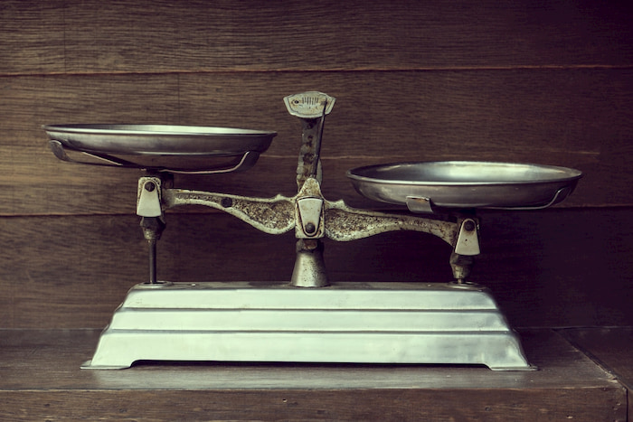 Pair of silver weighing scales on a stand